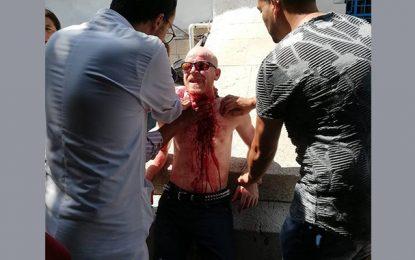 Un homme âgé s'entaille la gorge devant le ministère des Affaires sociales